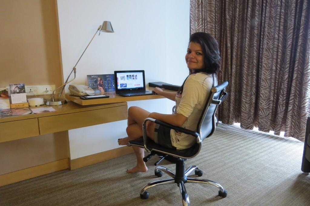 Working on my blog at the comfy workstation in my room