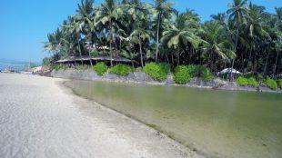 Lovely palm fringed lagoon at Cola