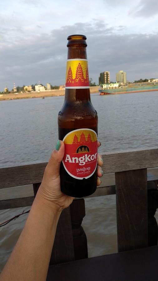 Sipping Ankor while cruising the Mekong