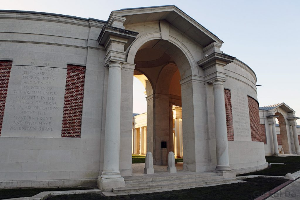 Entrance to the Faubourg d'Amiens Cemetery and Arras Memorial in Arras, France. The remains of 2651 Commonwealth soldiers and 30 non-Commonwealth soldiers are laid to rest in the cemetery. The names of 35,942 soldiers whose remains could not be identified or have no known grave are inscribed in the Arras Memorial.